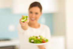 Woman giving salad Stock Images