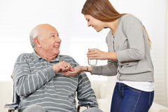 Woman giving senior man Stock Photo