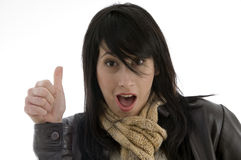 Woman giving shocking expression with thumbs up. Isolated on white background Royalty Free Stock Photos