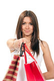 Woman giving shopping bags Royalty Free Stock Images