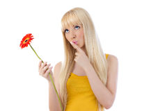 Woman giving silence gesture holding daisy Royalty Free Stock Images