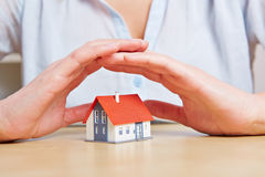 Woman giving small home safety Royalty Free Stock Photography