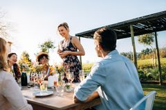 Woman celebrating a special occasion with friends Royalty Free Stock Photos