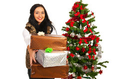 Woman giving stack of Christmas gifts Royalty Free Stock Image