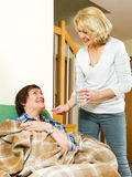 Woman giving  tablets elderly woman Stock Images