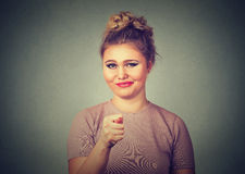 Woman giving thumb, finger figa gesture you get zero nothing Royalty Free Stock Photography