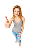 Woman giving thumb up full length standing isolated. Royalty Free Stock Photo