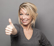 Woman giving the thumbs up Stock Photo