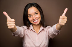Woman giving thumbs up approval hand sign gesture smiling happy Royalty Free Stock Images