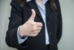 Woman giving thumbs up Royalty Free Stock Photography