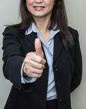 Woman giving thumbs up Royalty Free Stock Photo