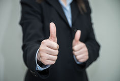 Woman giving thumbs up Royalty Free Stock Image