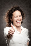 Woman giving a thumbs up sign Stock Images