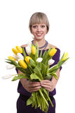 Woman is giving tulips Royalty Free Stock Photo