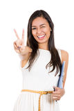Woman giving a victory sign / pointing while winking Royalty Free Stock Images