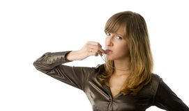 Woman giving a whistle. Young beauty blowing a whistle Royalty Free Stock Image