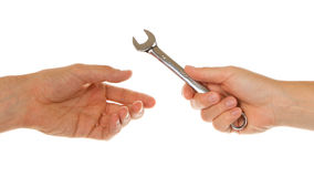 Woman giving wrench to man Royalty Free Stock Photo