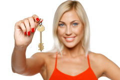 Woman giving you a key Stock Photography