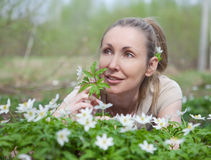 Woman on a glade of blossoming snowdrops in the early spring Royalty Free Stock Photo