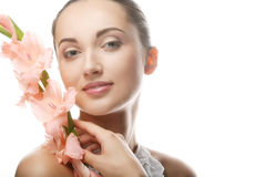 Woman with gladiolus flowers in her hands Stock Image
