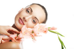 Woman with gladiolus flowers in her hands Royalty Free Stock Image