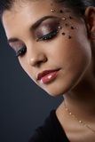 Woman in glamorous makeup. Closeup portrait of beautiful young woman in glamorous makeup with strasses Royalty Free Stock Photos