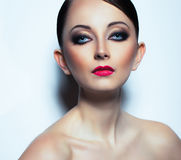 Woman with a glamorous retro makeup Stock Photography