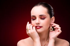 The woman in glamourous concept with jewelry Stock Photo