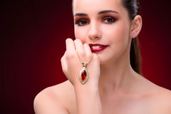 The woman in glamourous concept with jewelry Stock Photography