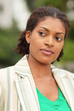 Woman glancing away. Image of a beautiful black woman glancing away from the camera Stock Photos