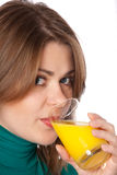 Woman with glass. Woman drinking juice isolated on white Stock Photos