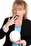 Woman with a glass ball fortune telling Royalty Free Stock Images