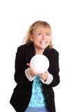 Woman with a glass ball fortune telling Stock Images