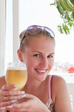 Woman with a glass of beer Royalty Free Stock Images