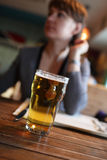 Woman with glass of beer Stock Photography