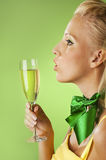 Woman with a glass of champagne Royalty Free Stock Photos