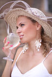 Woman with glass of champagne. Nice woman with glass of champagne portrait royalty free stock photography