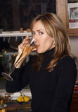 Woman with Glass of Champagne. Blond woman drinking a glass of champagne Royalty Free Stock Photography