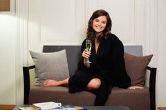 Woman  with glass of champagne in hotel room Royalty Free Stock Photo
