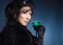 Woman with glass of cocktail Stock Image