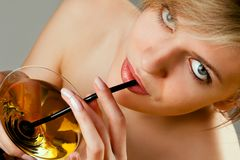 Woman with glass of cocktail Stock Photography