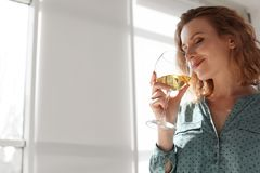Woman with glass of delicious wine indoors. Professional sommelier Stock Image