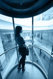 Woman in glass elevator Royalty Free Stock Photos