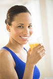Woman With Glass Of Fresh Orange Juice In Gym Royalty Free Stock Photos