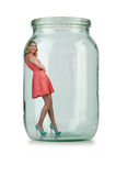 Woman in glass jar Stock Images