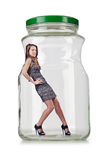 Woman in glass jar Stock Photography