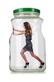 Woman in glass jar Royalty Free Stock Images