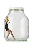 Woman in glass jar Royalty Free Stock Photos