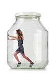 Woman in glass jar Stock Image