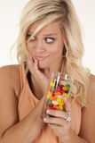 Woman with glass of jelly beans Royalty Free Stock Photos